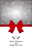 Christmas card with a red bow and snowflakes Stock Images