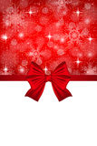 Christmas card with a red bow and snowflakes Royalty Free Stock Photography