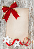 Christmas card with red bow, stars and ribbon Stock Image