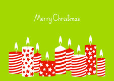 Christmas card with red candles. On green Stock Images