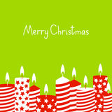 Christmas card with red candles. On green Royalty Free Stock Photo