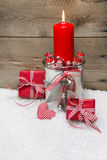 Christmas card with red candles, presents red and white Royalty Free Stock Photos