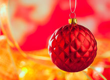 Christmas card of red capiton bauble on blur Royalty Free Stock Photo