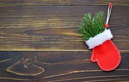 Christmas card with Christmas glove on wooden background. Christmas card with red Christmas glove on wooden background Stock Image