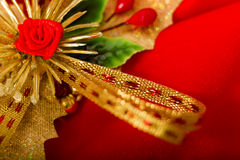 Christmas card. Red cloth with decorations Stock Photography