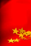 Christmas card. Red cloth with gold stars Stock Photo