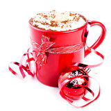 Christmas card with red coffee cup topped with whipped cream and Stock Images