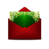 Christmas card in red envelope  over white Stock Photos