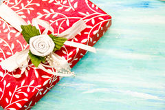 Christmas Card red gift box with silver ribbon. party invitation corporate event decoration turquoise shabby table wooden backgrou Royalty Free Stock Photo