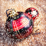 Christmas card with red glass balls on a wooden table. Red Chris Stock Photography
