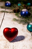 Christmas card with red heart Royalty Free Stock Photography