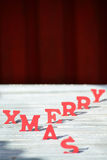 Christmas Card With Red Letters Merry Xmas On White Wood Stock Photos