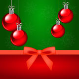Christmas card and red ornaments. On a green background Royalty Free Stock Photography