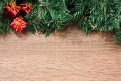 Christmas card. With red presents on wooden background Stock Photography