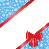 Christmas card with red ribbon bow. And blue background with snowflakes Royalty Free Stock Photo