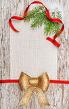 Christmas card with red ribbon, bow and fir branch Stock Image