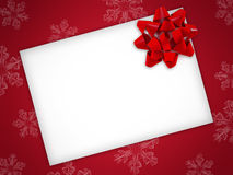 Christmas card with red ribbon on a red background. Christmas card with red ribbon. On a red background there are some snowflakes stock illustration