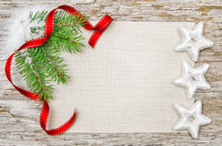 Christmas card with red ribbon, stars and fir branch Stock Image