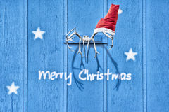 Christmas card with reindeer antlers and santas hat Royalty Free Stock Image