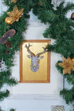 Christmas card with reindeer and green tree Stock Images
