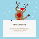 Christmas card with reindeer holding blank paper for your text. Stock Photography
