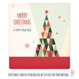Christmas card in retro design with place for your text Stock Photos