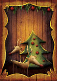 Christmas card - Rudolph with tree in wooden frame. Christmas card - Reindeer with tree in wooden frame. Cartoon childish deer with Xmas tree on wooden Royalty Free Stock Images