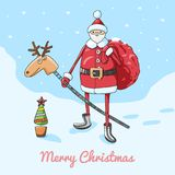Christmas card with Santa Claus with a bag of gifts on a toy deer Stock Photo