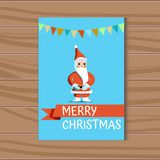 Xmas vector card with Santa Claus on a blue background. Christmas card with Santa Claus on a blue background with a multicolored festive ribbon and an Stock Image