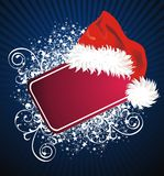 Christmas card with Santa Claus hat Royalty Free Stock Photos