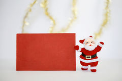 Christmas card and Santa clause doll Royalty Free Stock Photos