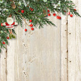 Christmas card with Santa and red berries on vintage wooden. Christmas wood background with Santa and Christmas decorations made of branches, holly  for Stock Photo