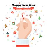 Christmas card with Santa`s hand holding candy cane. Flat design. Christmas traditional decoration elements for greeting card, banners, websites, infographics Stock Photo