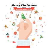 Christmas card with Santa`s hand holding fir tree. Flat design. Christmas traditional decoration elements for greeting card, banners, websites, infographics Stock Photo