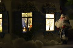 Christmas card with Santa and shining windows. Wonderful retro picture of Father Frost with New Year windows in Russian style Stock Image