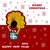 Christmas card with a sheep giving a gift Royalty Free Stock Photo