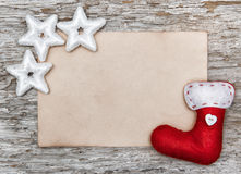 Christmas card with sheet of paper and red sock Stock Photo
