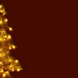 Christmas Card - Shining Tree. Christmas card with the half of a decoration tree, shining in numerous lights on dark background royalty free stock photos
