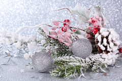 Christmas card with silver balls. Christmas composition with balls and fir branches on a silver background stock photos