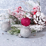 Christmas card with silver balls. Christmas composition with balls and fir branches on a silver background stock images
