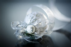 Christmas card with silver balls and ribbon. On a black background stock photo