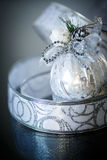 Christmas card with silver balls and ribbon Royalty Free Stock Photo