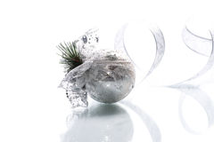 Christmas card with silver balls and ribbon. On a white background royalty free stock photo