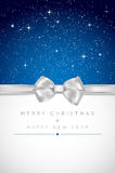 Christmas card with silver bow, shiny stars and place for your m Royalty Free Stock Images