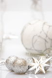 Christmas card with silver star and balls. On white background Royalty Free Stock Photography