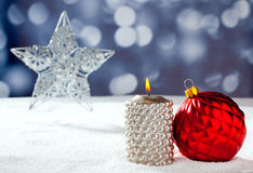 Christmas card of silver star bauble and candle Royalty Free Stock Images