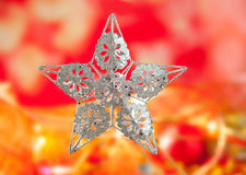 Christmas card of silver star and red blur Royalty Free Stock Photography