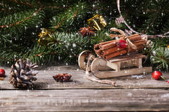 Christmas card with sled and cinnamon Royalty Free Stock Photos