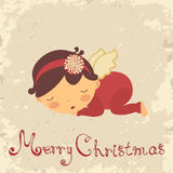 Christmas card with sleeping newborn angel. Vintage Christmas card with sleeping newborn angel Stock Photo