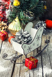 Christmas card with sleigh and ornaments Stock Photography